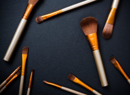 tool kit: Professional makeup brushes collection, new make-up tools set on black background with copy space