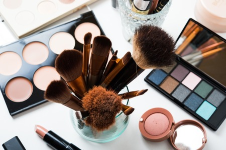Professional makeup brushes and tools, natural make-up products set on white table. Archivio Fotografico
