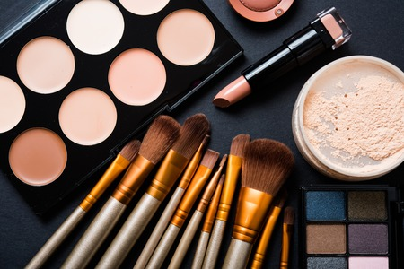 Professional makeup brushes and tools collection, make-up products set on black  table background. Stok Fotoğraf