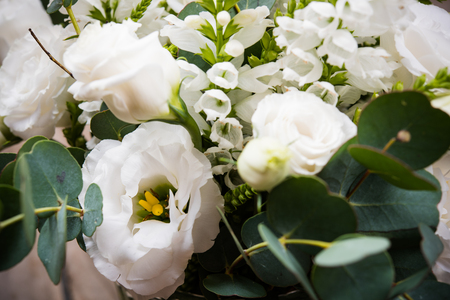 white flowers: Elegant white bouquet of flowers and leaves macro closeup shot Stock Photo