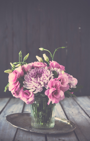 arrangements: Bouquet of pink flowers in a vase, eustoma and chrysanthemum, elegant vintage rustic home decor