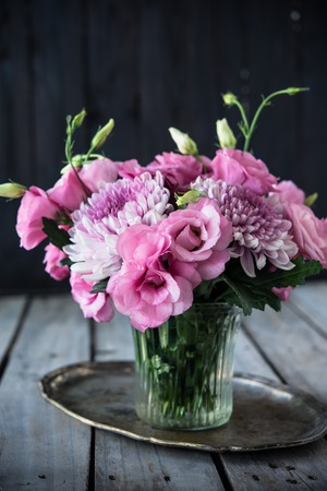 Bouquet Of Pink Flowers In A Vase Eustoma And Chrysanthemum
