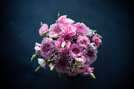 Bouquet of pink flowers closeup on black background, eustoma and chrysanthemum, elegant vintage floral decor, top view Zdjęcie Seryjne - 63737998