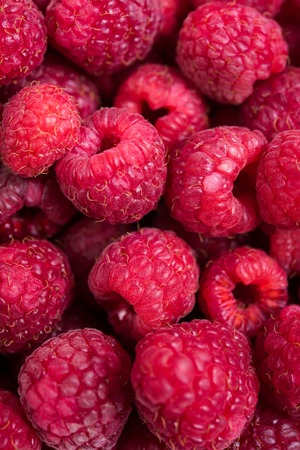 summer diet: Fresh ripe raspberries macro shot, summer fruit background, vegan diet food