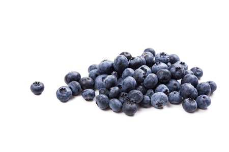 summer diet: bunch of ripe blueberries isolated macro shot, summer fruit background, vegan diet food