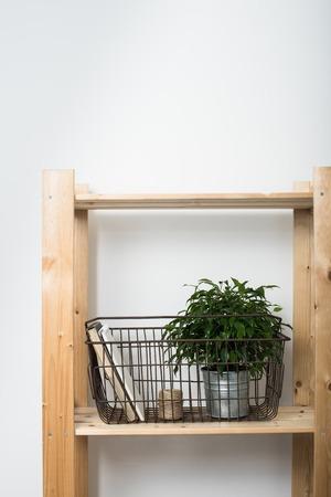 wall decor: Simple minimalist furniture, wooden shelf with home interior decor.
