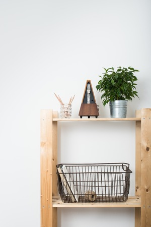 furniture home: Simple minimalist furniture, wooden shelf with home interior decor.