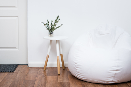 decoration objects: Scandinavian home interior decoration, simple decor objects and bean bag chair, minimalist white room