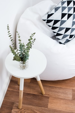 Scandinavian home interior decoration, simple decor objects and bean bag chair, minimalist white room Zdjęcie Seryjne - 63740619