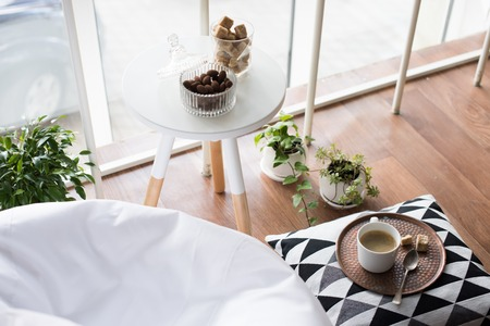 comfort food: Coffee served on table in bright light scandinavian style hipster interior, cozy loft room with large windows closeup Stock Photo