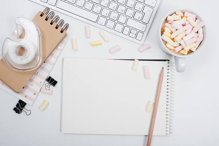 styled: White feminine hipster workspace background, styled womans office table with coffee and marshmallows
