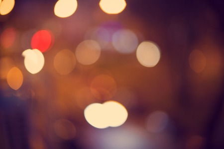 night background: Beautiful light bokeh abstract background. Holiday night city lights.