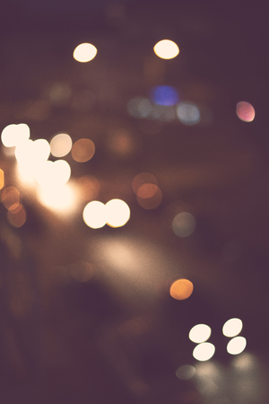 Beautiful light bokeh abstract background. Holiday night city lights.