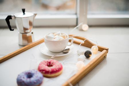 tazas de cafe: Cozy home weekend, coffee and sweets in tray on floor, warm winter indoors