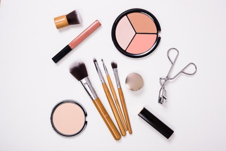cosmetics products: Professional makeup brushes and tools, make-up products kit, flatlay on white background