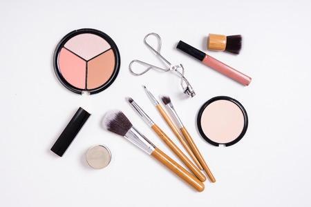 up view: Professional makeup brushes and tools, make-up products kit, flatlay on white background