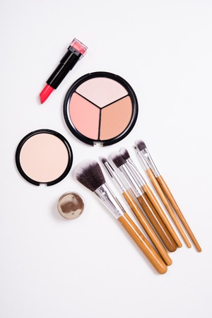 visage: Professional makeup brushes and tools, make-up products kit, flatlay on white background