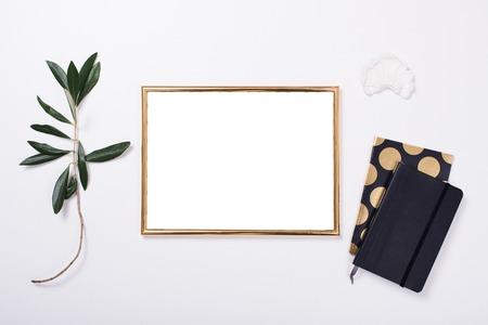Golden frame mock-up on white tabletop