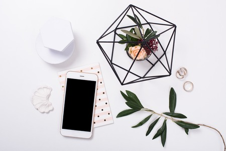 feminine tabletop flatlay with smartphone mock-up