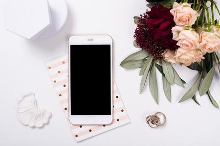 feminine tabletop flatlay with smartphone mock-up