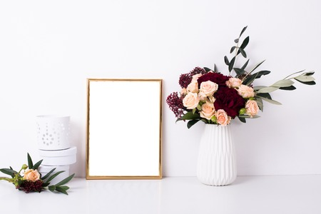 Golden frame mock-up on white wall Reklamní fotografie