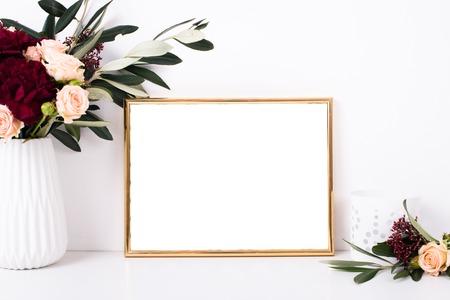 Golden frame mock-up on white wall