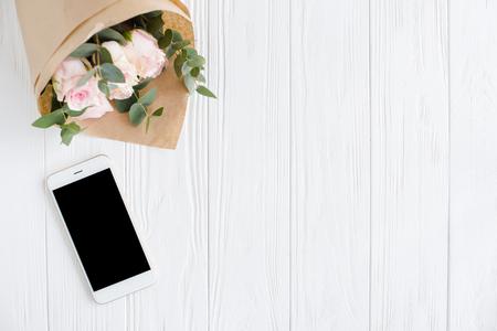 Simple feminine background with smartphote Standard-Bild