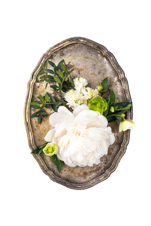 peony flowers arrangement in old vintage tray on white backgroun