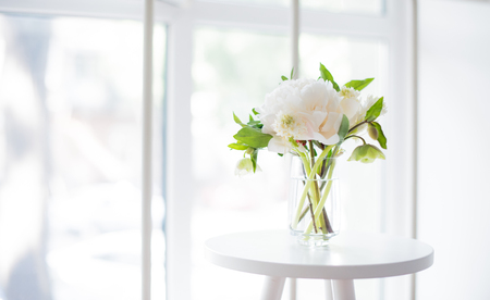 white peony flowers on coffee table in white room interior, brig Stock fotó - 80150269