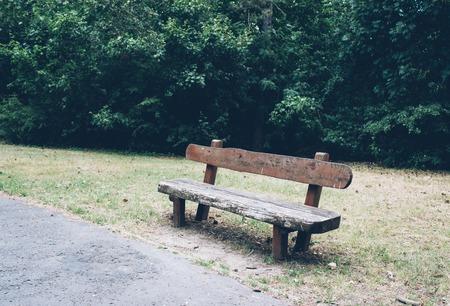 old wooden bench in an abandoned city park