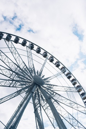 Ferris wheel details on a cloudy sky background Stock Photo