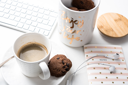 Cup of coffee and jar of chocolate cookies on breakfast table, morning meal Stock fotó - 83401794