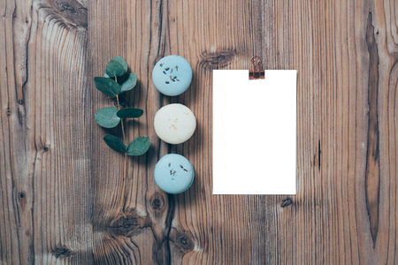 Beige and blue macaroons and blank postcard mockup