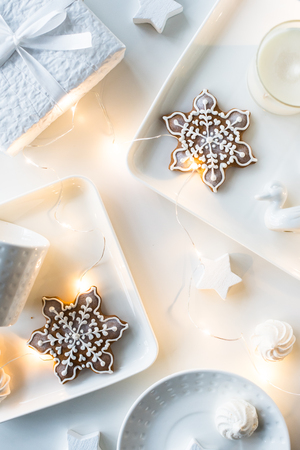 White Christmas gifts and decorations, presents and sweets, holi