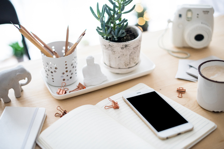 office desk flat lay with coffe, smartphone and succulents, styl Standard-Bild