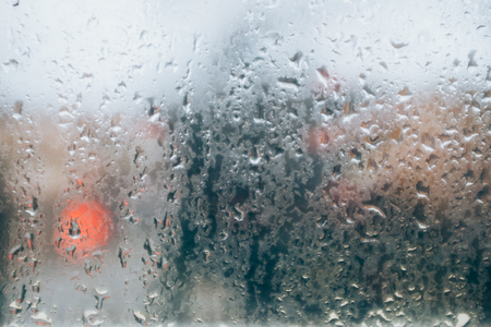 Wet window glass texture on rainy day