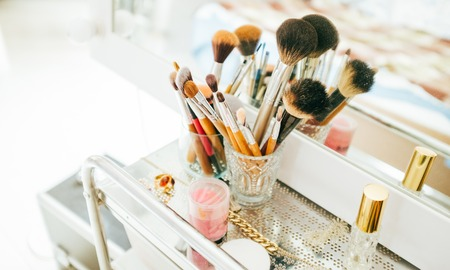 Make-up brushes and cosmetic on dressing table 스톡 콘텐츠 - 96720656