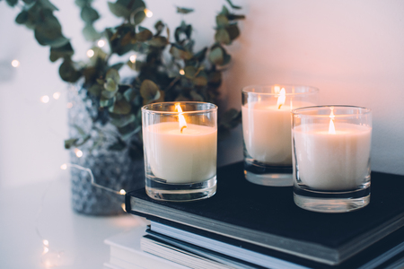 Cozy home interior decor, burning candles Stok Fotoğraf