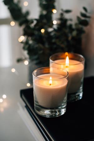 Cozy home interior decor, burning candles Stock fotó