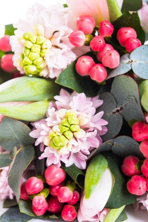 Bunch of pink hyacinths, decorative berries and tulips, festive bouquet of fresh spring flowers macro closeup