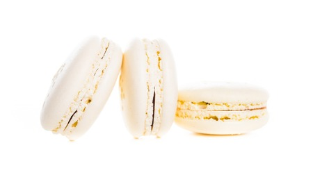 Exquisite french dessert, cream macaron cakes on a white background isolated