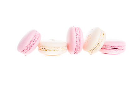 Exquisite french dessert, pink and cream macaron cakes on a white background isolated Reklamní fotografie