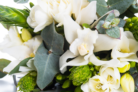 Sophisticated bridal bouquet of flowers, white freesias and orchids on a white background isolated 写真素材