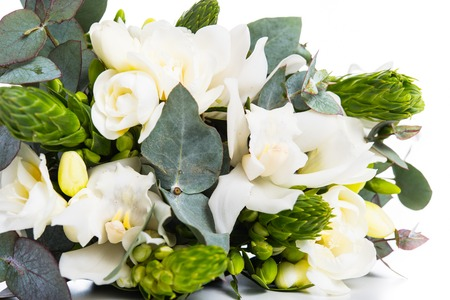 Sophisticated bridal bouquet of flowers, white freesias and orchids on a white background isolated Stok Fotoğraf
