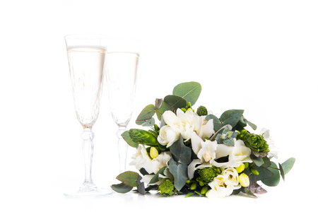 Sophisticated bridal bouquet of flowers and champagne, white freesias and orchids on a white background isolated Reklamní fotografie