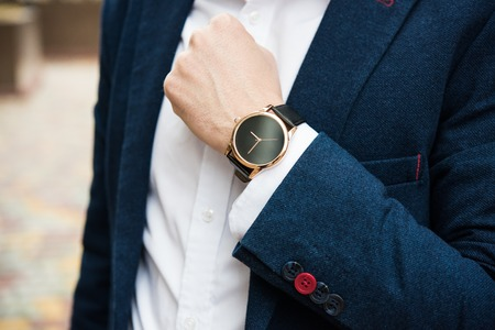Elegant man in blue suit, business mans hand with fashion