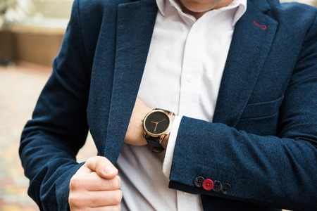 Elegant man in blue suit, business mans hand with fashion no br