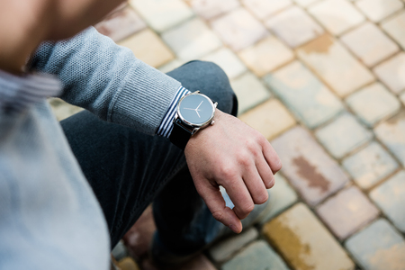 Stylish man in gray jumper, elegant business mans hand with fashion Stock Photo