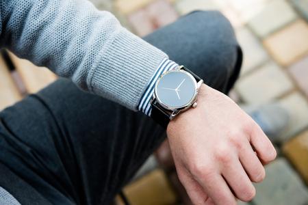 Stylish man in gray jumper, elegant business mans hand Stock Photo