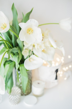 Large bouquet of white spring flowers in a vase, daffodils, tuli Stok Fotoğraf